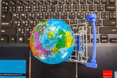 Top view shopping cart with world globe balloon map for retail business on notebook. Image use for online and offline shopping. Marketing place world wide stock photos