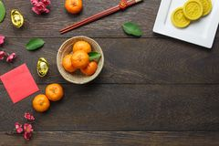 Top view shot of arrangement decoration Chinese new year & lunar holiday. Background concept.Flat lay orange & dessert also red pocket money on modern brown Stock Photo