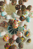 Top view shot of colorful pop cake against white wooden backgrou Stock Image