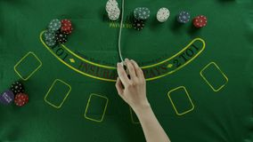 Top view shot. A gambler using a computer mouse to add more poker chips stock video footage
