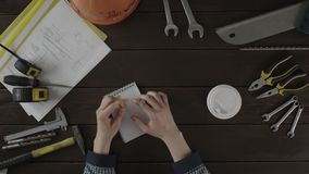 Top view shot. A guy is preparing his working place. A guy is organising his working place stock footage