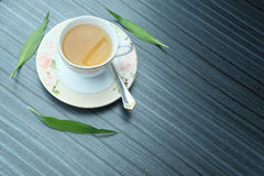 Top view shot of a hot cup of tea with green leaf decoration on blue background , Organic green Tea ceremony time Stock Photos