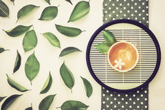 Top view shot of a hot cup of tea with green leaf decoration  , Stock Images