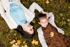 Top view shot of mother and little daughter lying. On grass stock photos