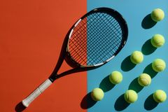 Tennis racket and balls. Top view shot of and tennis racket and balls placed on two toned surface stock photography