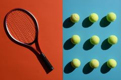 Tennis racket and balls. Top view shot of and tennis racket and balls placed on two toned surface stock image