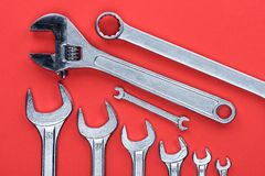 Wrenches. Top view shot of various wrenches, isolated on red Royalty Free Stock Image