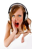 Top view of shouting female enjoying music. With white background Royalty Free Stock Images