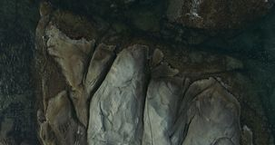 Top view showing plane rocks and a transparent clean sea water with a water-plants in it moving stock footage