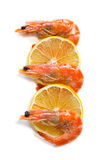 Top view of shrimp and lemon slices on isolated background Stock Photo