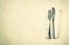 Top view of silver fork and knife over wooden textured background. room for text. Stock Photography