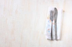 Top view of silver fork and knife over wooden textured background. room for text. Royalty Free Stock Images