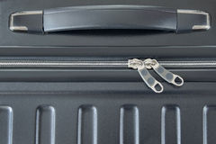 Top view of silver zipper of hard shelled suitcase, new and clea Royalty Free Stock Images