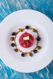 Top view on single portion of beef tartar steak on white plate Royalty Free Stock Photo