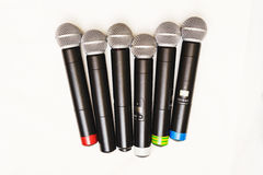 Top view of six black wireless professional microphones. Top view of six black wireless professional microphones prepared for leading or musicians on a white Stock Photo