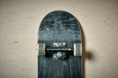 Top view of skateboard on wooden background Royalty Free Stock Images