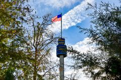 Top view of Sky Tower, USA Flag and Trees at Seaworld in International Drive area. stock image