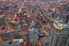 Top view skyline cityscape of Chicago. From John Hancock Center at dusk, IL, USA. Modern buildings light up in downtown Stock Photography