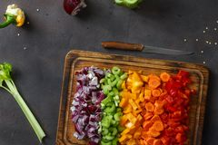 Top view sliced fresh vegetables serving cutting board. Top view sliced fresh vegetables serving on cutting board on dark background Stock Photos