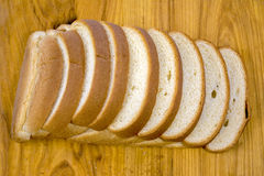 Top view of a sliced loaf of bread on a cutting board Stock Photography
