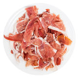 Top view sliced prosciutto crudo on plate isolated Royalty Free Stock Photo