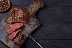 Top view sliced steak on cutting board. With copy space for your text Royalty Free Stock Photography