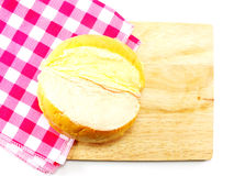Top view of slices bread with butter on a rustic wooden cutting board Stock Photo