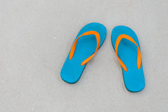 Top view slipper on sand Stock Photos
