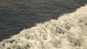 Foamy crashing waves from sea motorboat. Top view slow motion, Full HD video, 240fps, 1080p. Top view slow motion large foamy waves from sea ship. Slow motion stock video