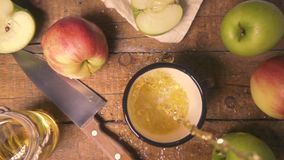 Top view slow motion pours apple juice in a mug stock footage