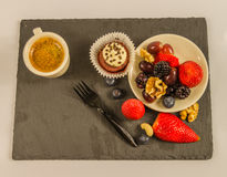 Top view of a small black coffee and a set of various nuts and f Stock Photo