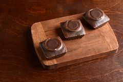 Top view small dark chocolate covered cakes royalty free stock images