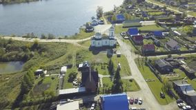 Top view of the small resort town near a lake. Video. Top view of the village near the forest and lake.  stock footage