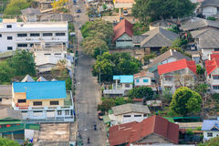 Top view of small town with many houses and some small building and local road pass through. Stock Photo