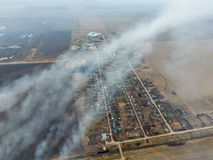Top view of the small village. Smoke from the burning of straw i royalty free stock photo
