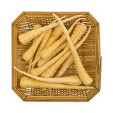 Parsnips in a wood basket. Top view of a small wood basket filled with whole parsnips isolated on a white background Stock Photography