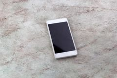 Top view smart phone. Marble background Royalty Free Stock Photo
