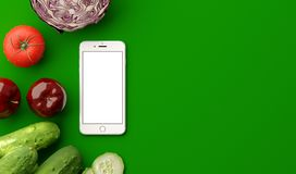 Top view of smartphone with blank screen and fresh raw vegetables on green table. 3D illustration. Top view of smartphone with blank screen and fresh raw Stock Images