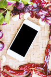 Top view smartphone with collection of fresh onions and chilis Stock Photo