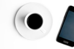 Top of view of smartphone and cup of coffee Stock Photo