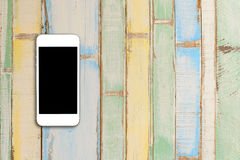 Top view smartphone mock up template with black screen on wooden Royalty Free Stock Photography