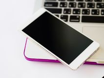 Top view of smartphone put on laptop.work place concept. royalty free stock photo