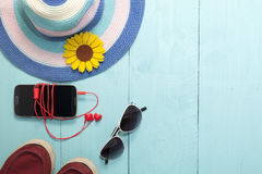 Top view of smartphone, red earphone ,sunglasses with hat and sh Royalty Free Stock Image