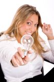 Top view of smiling businesswoman showing bulb Stock Photos