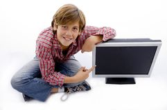 Top view of smiling child pointing at tv Stock Images