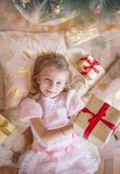 Smiling female kid with lots of presents Stock Images