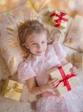 Top view of smiling kid with lots of presents Stock Photos