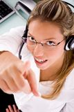 Top view of smiling service provider pointing up Stock Photos