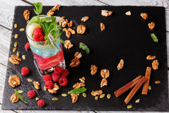 Top view of a smoothie and organic ingredients on a table background. Sweet cold milkshake with mint and raspberries royalty free stock photo