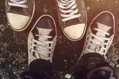 Top view of sneakers from above on asphalt road Royalty Free Stock Photography